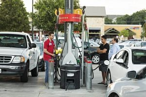 An employee informs customers of a fuel shortage at an HEB Fuel gas station in Houston, Texas, US.
