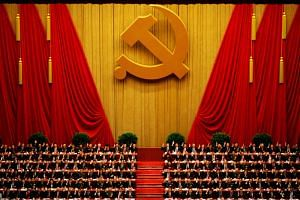 A general view shows delegates raising their hands as they take a vote at the closing session of the 18th National Congress of the Communist Party of China at the Great Hall of the People in Beijing November 14, 2012.
