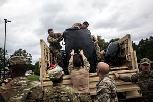 The 1st Battalion (Airborne), 143rd Infantry Regiment of the Texas Army National Guard prepare and stage for rescue missions near Liberty, Texas.