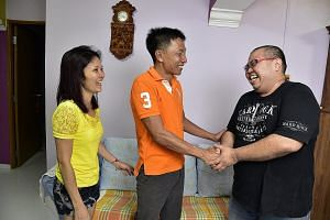 Mr Shoo Chiau Huat and his wife Jasmine greeting their neighbour Rick Ang, 36, an engineer, at their home in Sengkang on Wednesday night. It was the first time Mr Ang was meeting Mr Shoo, who was in detention in Indonesia for 16 months before being r