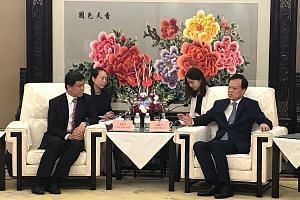 Mr Chan Chun Sing meeting Mr Chen Min'er, Chongqing party chief, in the Chinese city yesterday. The two discussed ways to deepen collaboration over the Chongqing Connectivity Initiative, a Singapore-China joint project to boost regional links.