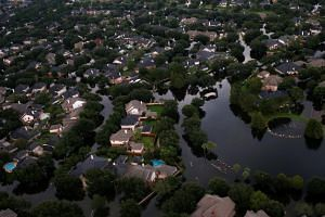 Houses partially submerged in flood waters caused by Tropical Storm Harvey in Northwest Houston, Texas on Aug 30, 2017.