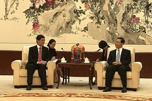 Minister in the Prime Minister's Office Chan Chun Sing with Guangxi party boss Peng Qinghua in Nanning yesterday. Mr Peng expressed strong support for the Southern Transport Corridor, said Mr Chan.
