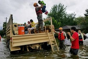 Texas National Guard soldiers aid residents in heavily flooded areas from the storms of Hurricane Harvey in Houston, Texas, US on Aug 27, 2017.