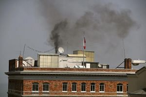 Black smoke billows from a chimney on top of the Russian consulate on Sept 1, 2017 in San Francisco, California.