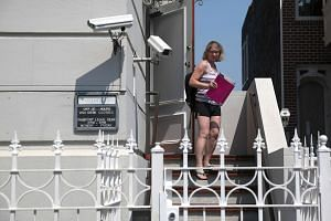 A woman leaves the Russian consulate on Sept 1, 2017, in San Francisco, California.