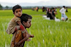 Rohingya children after crossing the border into Teknaf, Bangladesh, last Friday. The World Food Programme has suspended aid in Rakhine as the humanitarian situation has deteriorated.