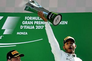 A jubilant Lewis Hamilton on the podium after his emphatic victory in the Italian Grand Prix yesterday. It was his sixth win of the season, giving the Mercedes driver a three-point lead over Ferrari rival Sebastian Vettel in the World Championship, w