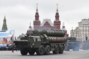 Russian S-400 Triumph medium-range and long-range surface-to-air missile systems riding through Red Square during the Victory Day military parade in Moscow in May.