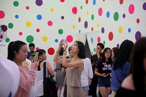 Visitors at Yayoi Kusama's Life Is The Heart Of A Rainbow exhibition at the National Gallery Singapore.
