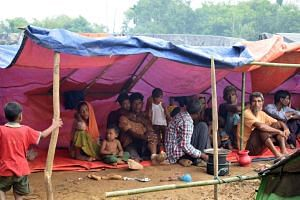 Rohingya refugees resting under a makeshift tent in a meadow in Ukhiya, Bangladesh, on Sept 3, 2017.