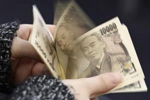 A woman counting Japanese 10,000 yen notes. Investors turned to haven assets after North Korea tested a nuclear bomb on Sunday, sending the yen, gold and Treasury futures higher.