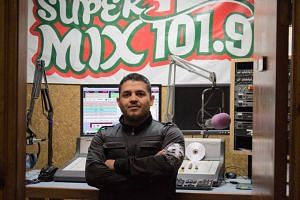 Alonso Guillen is pictured at his job as a radio host in Lufkin, Texas.