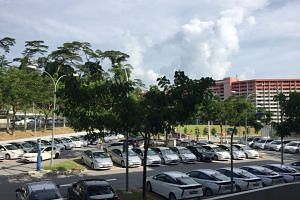 Private-hire cars parked at Singapore General Hospital.