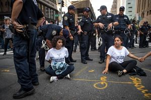 Immigration activists protesting the Trump administration's decision on the Deferred Action for Childhood Arrivals are arrested by New York City Police officers on 5th Avenue, on Sept 5, 2017.