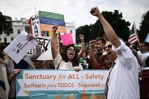 Immigrants and supporters demonstrating in front of the White House on Tuesday, at a rally in support of the Deferred Action for Childhood Arrivals (Daca). Congress has been given six months to reform the US' immigration laws - leaving some hope for