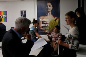 Volunteers prepare to make calls at a centre for the Yes campaign in Australia's gay marriage vote, as Australia's high court continues a hearing on the validity of a government plan for a postal vote to legalise same-sex marriage, on Sept 6, 2017.