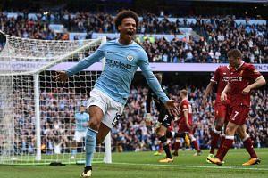 Manchester City's German midfielder Leroy Sane celebrates after scoring their fourth goal.