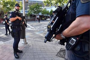 Police officers stand guard around the Bernabeu stadium in Madrid, Spain on Sept 1, 2017.