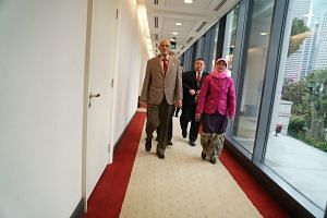 Madam Halimah Yacob and her husband, Mr Mohamed Abdullah Alhabshee, in Parliament House on Monday (Sept 11).