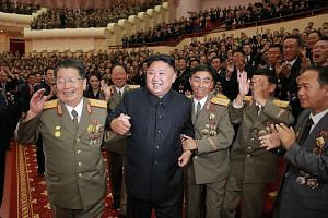 Leader Kim Jong Un attending an art performance at the People's Theatre in Pyongyang which was dedicated to nuclear scientists and technicians who worked on a hydrogen bomb which the regime claimed to have tested successfully.