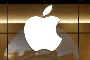 The Apple logo is seen on the facade of an Apple store in Paris on Jan 5, 2017.