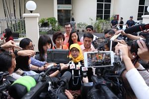 Madam Halimah Yacob talks to the media outside the Elections Department on Sept 11, 2017.