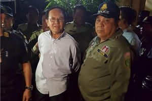 Cambodian opposition leader Kem Sokha is detained during a police raid at his home in Phnom Penh on Sept 3, 2017.