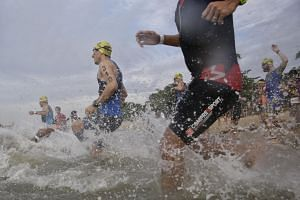 Participants dashing towards the sea during the Singapore International Triathlon 2017 National Championships at East Coast Park on Sept 10, 2017.
