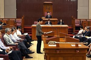 Mr Tan Chuan-Jin (in Speaker's chair at the back) at his first sitting as Singapore's 10th Speaker yesterday. He pledged to be fair and firm, and called on MPs to debate vigorously while maintaining mutual respect.