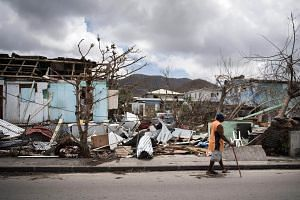 A man walks on a street in Marigot on the island of Saint-Martin after it was devastated by Hurricane Irma on Sept 10, 2017.