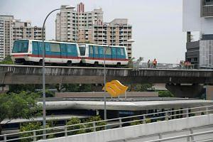 Repair work being carried out on the Bukit Panjang LRT tracks.