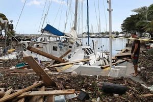 A damaged boat is seen at the Dinner Key marina after Hurricane Irma passed through the area on Sept11, 2017 in Miami, Florida.