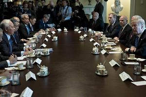 Malaysian Prime Minister Najib Razak (left) meets with US President Donald Trump in the Cabinet Room of the White House on Sept 12, 2017.