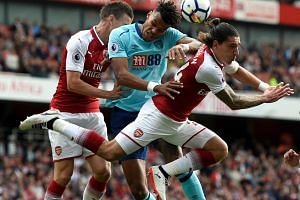 Bournemouth's Tyrone Mings in action with Arsenal's Laurent Koscielny (L) and Hector Bellerin on Sept 9, 2017.