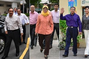 From left: Mr Farid Khan, Madam Halimah Yacob and Mr Salleh Marican, seen here with his wife, Madam Sapiyah Abu Bakar. Mr Khan and Mr Marican were deemed ineligible to contest the election.