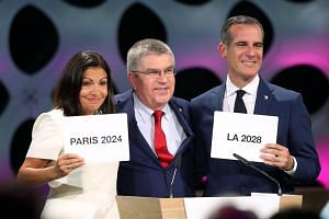 (From left) Paris Mayor Anne Hidalgo, IOC president Thomas Bach and Los Angeles Mayor Eric Garcetti after the announcement.