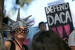 Protesters demonstrating in support of the Deferred Action for Childhood Arrivals (DACA) programme in Los Angeles on Sept 10, 2017.