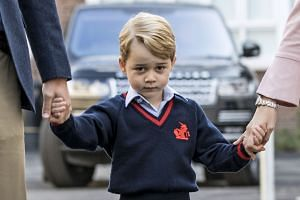 Britain's Prince George arrives for his first day of school in London, Sept 7, 2017.