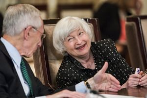 Yellen (right) chats with vice-chairman Stanley Fischer after a Federal Reserve meeting, Sept 1, 2017.