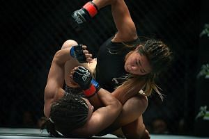 Singapore's Angela Lee (right) getting the better of Japan's Mei Yamaguchi during their fight last year. Lee won to claim the inaugural One Championship atomweight title and that belt will be on the line again on Nov 24.