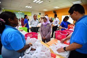 President Halimah Yacob speaking to retail trainees.
