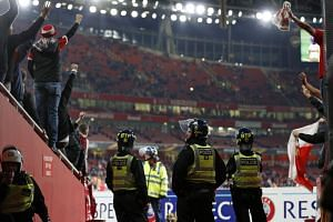 Police inside the stadium keep an eye on Cologne supporters in the stands ahead of the UEFA Europa League Group H football match between Arsenal and FC Cologne at The Emirates Stadium in London on Sept 14, 2017.