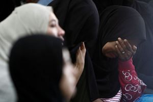 Family members wait for news of their loved ones outside religious school Darul Quran Ittifaqiyah after a fire broke out in Kuala Lumpur, Malaysia on Sept 14, 2017.