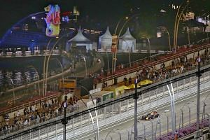 Red Bull Racing team driver Daniel Ricciardo of Australia in action during the second practice session of the Singapore Grand Prix at the Marina Bay Street Circuit as seen from Swissotel The Stamford hotel yesterday. Hotels have enjoyed brisk busines