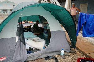 A man looks at his tent as it rains, following Hurricane Irma in Cudjoe Key, Florida, US, on Sept 14, 2017.
