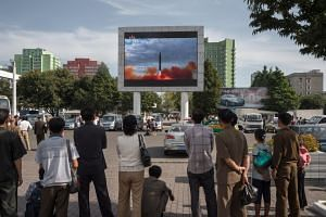 People observe the launch of a Hwasong-12 rocket in Pyongyang on Sept 16, 2017.