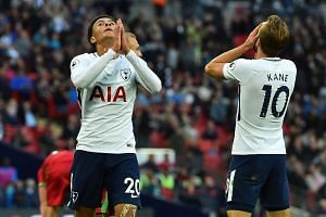 Tottenham's Dele Alli (left) and Harry Kane react to missing a chance.