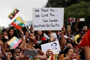Supporters of Myanmar State Counselor Aung San Suu Kyi react while listening to her speech to the nation over the Rakhine and Rohingya situation, in Yangon, on Sep 19, 2017.