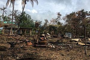 A burnt house is seen in a village near Maungdaw, in the north of Rakhine state, Myanmar, on Sept 12, 2017.